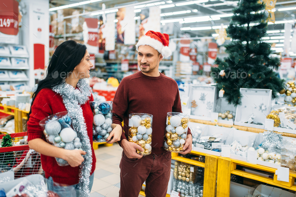 Young couple with boxes full of Christmas balls - Stock Photo - Images