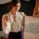 Female artist standing against easel in studio - PhotoDune Item for Sale