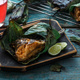 Close view of sambal stingray or malaysian grilled stingray wings in a leaf - PhotoDune Item for Sale