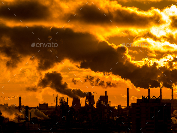 Industrial plant emitting heavy smoke - Stock Photo - Images