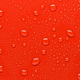 Water drops bright on red surface made of synthetic material - PhotoDune Item for Sale