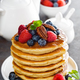Stack of fluffy pancakes with fresh berries and pecan nuts - PhotoDune Item for Sale
