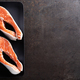 Fresh salmon fish steaks on black background top view - PhotoDune Item for Sale