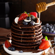 Stack of chocolate pancakes with berries, strawberry, raspberry and blueberry - PhotoDune Item for Sale