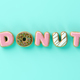 Delicious donuts with shape of letters glaze on yellow background 3D illustration - PhotoDune Item for Sale