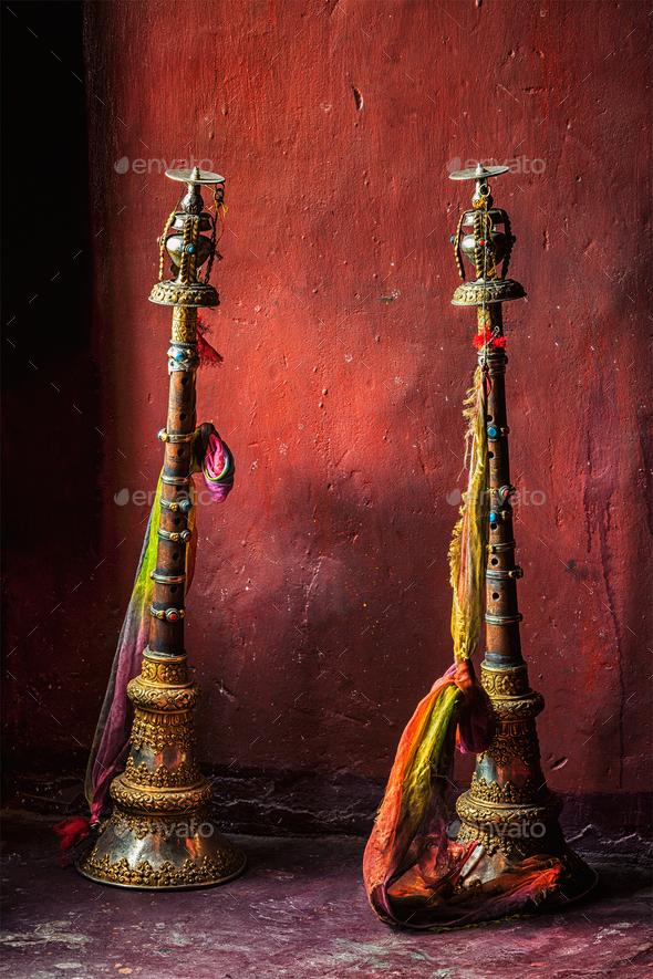 Buddhist prayer horns in Tibetan monastery - Stock Photo - Images