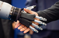 Hand of a businessman shaking hands with a Android robot. - PhotoDune Item for Sale