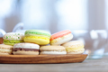 Close-up of colorful macaron (macaroon) on the table with hot te - PhotoDune Item for Sale