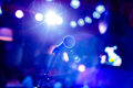 Microphone on stage against a background of auditorium. - PhotoDune Item for Sale
