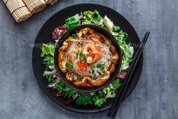 Asian salad with rice noodles with shrimps and vegetables closeup - Stock Photo - Images