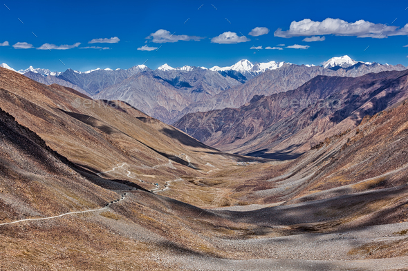 Karakorum Range and road in valley, Ladakh, India - Stock Photo - Images