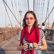 Smiling photographer on Brooklyn Bridge - PhotoDune Item for Sale