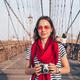 Smiling photographer on Brooklyn Bridge - PhotoDune Item for Sale