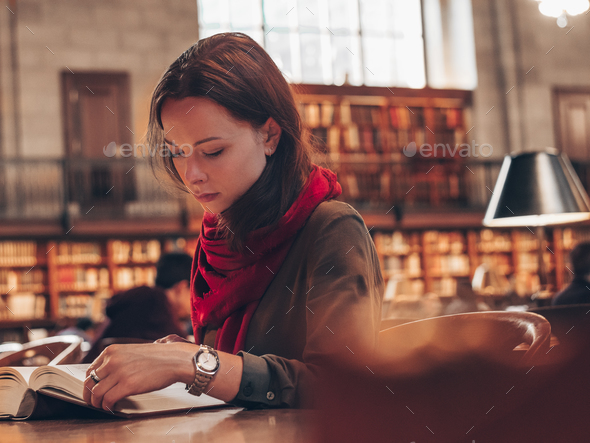 Attractive girl in the library - Stock Photo - Images