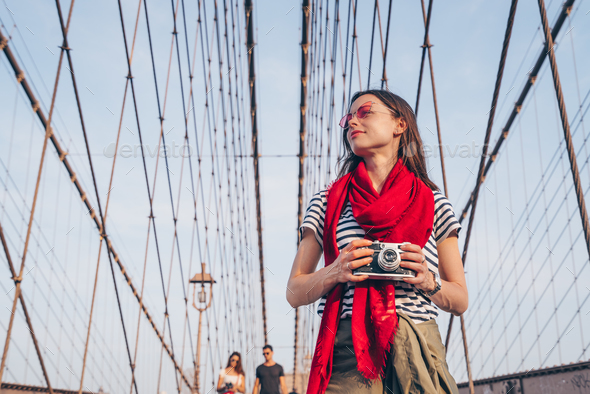 Young tourist on Brooklyn Bridge - Stock Photo - Images