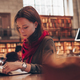 Attractive girl in the library - PhotoDune Item for Sale