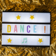 Text Dance on white illuminated board. Conceptual message for en - PhotoDune Item for Sale