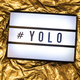Text YOLO on white illuminated board. You only live once concept - PhotoDune Item for Sale