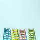 Multicoloured ladders on wall. Pastel tones. Concept for success - PhotoDune Item for Sale