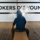 Teenager smoking and message on wall - Smokers die younger. No s - PhotoDune Item for Sale