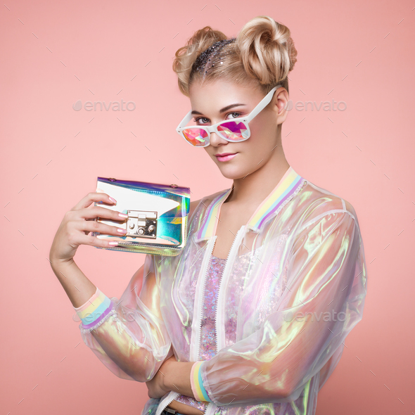 Blonde young woman in holographic jacket - Stock Photo - Images