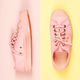 Pair of pink canvas sneakers, close up - PhotoDune Item for Sale