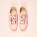Pink canvas sneakers on pink background, close up - PhotoDune Item for Sale