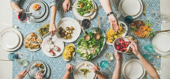 Mediterranean style dinner with various snacks and drinks, wide composition - Stock Photo - Images