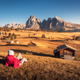 Lying woman on the hill is looking on meadows and mountains - PhotoDune Item for Sale