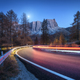 Blurred car headlights on winding road in mountains at night - PhotoDune Item for Sale