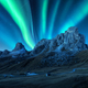 Northern lights above mountains at night. Aurora borealis - PhotoDune Item for Sale