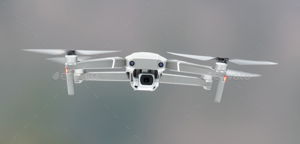 Drone quadcopter with digital camera - Stock Photo - Images