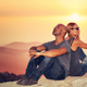 Happy couple enjoying sunset view - PhotoDune Item for Sale