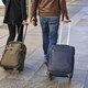 Young couple with baggage on the street. Travel and tourism - PhotoDune Item for Sale