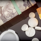 Boat of white pills along with tickets of dollar, concept of sanitary copayment - PhotoDune Item for Sale