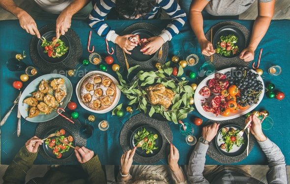 People eating different meals at Christmas party dinner, top view - Stock Photo - Images