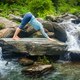 Woman doing yoga oudoors at tropical waterfall - PhotoDune Item for Sale