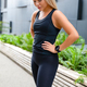 Confident Attractive Athletic Woman Standing Against Building In City - PhotoDune Item for Sale