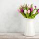 Fresh colorful tulips in a jug - PhotoDune Item for Sale
