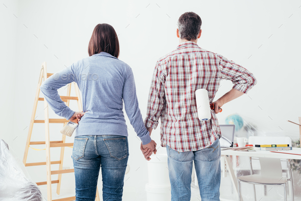 Couple doing a home makeover - Stock Photo - Images