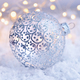 Christmas decorative ball on snow and Christmas lights. Festive - PhotoDune Item for Sale