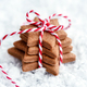 Christmas cookies - fresh baked star shaped biscuits on the snow - PhotoDune Item for Sale