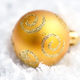 Christmas golden ball on snow. Close-up - PhotoDune Item for Sale