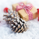 Close-up pine cones with christmas gift on the snow - PhotoDune Item for Sale