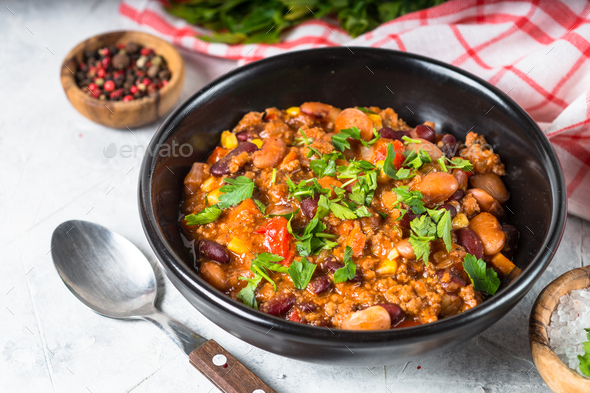 Chili con carne from meat and vegetables on stone table close up. - Stock Photo - Images