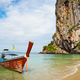 Long tail boat at a tropical beach. - PhotoDune Item for Sale