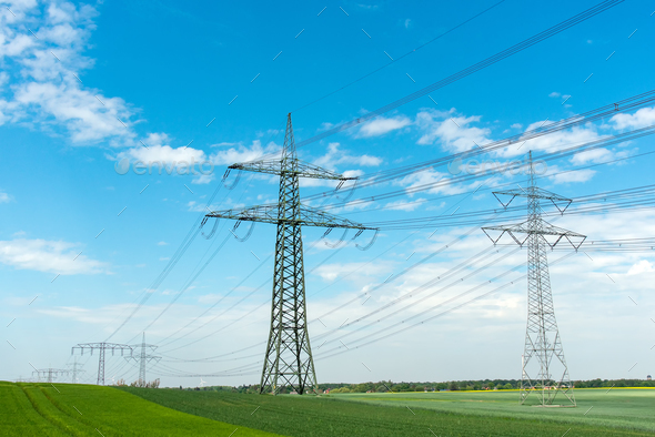 High-voltage lines on a sunny day  - Stock Photo - Images