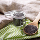 Raw Chia seeds in glass airtight jar and bamboo spatula on woode - PhotoDune Item for Sale