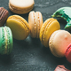 Colorful French macaroons over black background, wide composition - PhotoDune Item for Sale