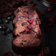 Uncut chocolate cake with pieces of chocolate and red currants on rough gray background - PhotoDune Item for Sale